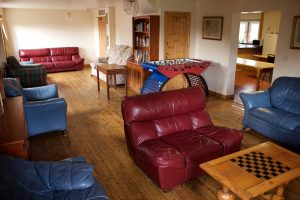 Lounge from log fire end of room
